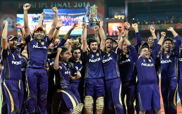 KKR players and staff with the IPL trophy after their win over KXIP by three wickets in the final in Bangalore on Sunday. This is KKR's second title in three years. KKR started on a disastrous note losing three out of the first five matches but the fortunes took a turn after IPL returned to India. KKR's Robin Uthappa was awarded the orange cap and Manish Pandey was the man-of-the-match in the final. (Source: PTI)