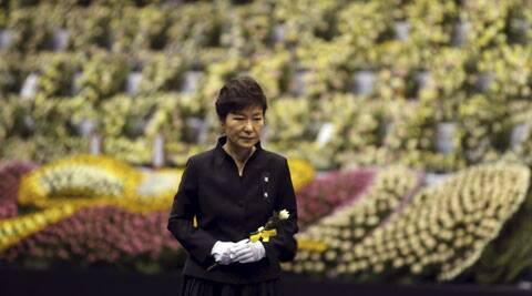 South Korean President Park Geun-hye pays tribute to the victims of the sunken ferry Sewol at a group memorial altar in Ansan, South Korea. (Source: AP)