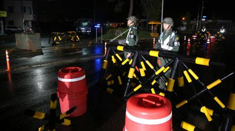 South Korean army soldiers stand guard at a temporary checkpoint in Goseong, South Korea. (Source: AP)