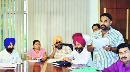 During the auction of the parking lots at MC office in Ludhiana on Thursday. ( Source:Gurmeet Singh)