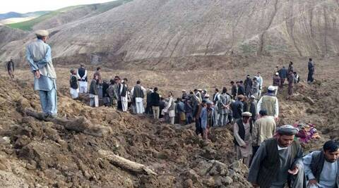 Local civilians search for survivors after a massive landslide that killed nearly 300 in Afghanistan. (AP)