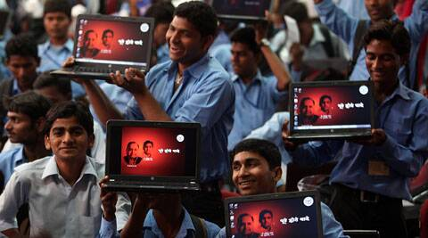 Class 12th pass students enjoying after got  the laptops distribute by Uttar Pradesh Government today. Uttar Pradesh Chief Minister Akhilesh Yadav start free Laptop distribution scheme for State. on Monday. (Express Photo by Vishal Srivastav.)