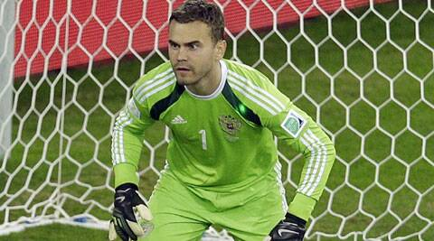 Russia's goalkeeper Igor Akinfeev is shown with a green laser dot on his shoulder during their mach against Algeria (Source: AP)