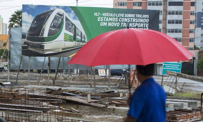 The soccer tournament will leave the country with some of the world's most costliest soccer stadiums. What the World Cup also promised was more public transport. This photo shows a man walking near the construction site for the light-rail vehicle (known in Brazil as VLT) that was planned to be ready in time for the 2014 World Cup, in Fortaleza, one of the tournament's host cities and the second most expensive city after Rio de Janeiro. The tourists as well as the fans will find it difficult to match the ever rising prices in the country. (Source: Reuters)