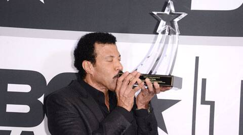 Lionel Richie poses in the press room with the lifetime achievement award at the BET Awards at the Nokia Theatre on Sunday, June 29, 2014, in Los Angeles. (Source: AP)