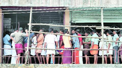 Queue outside a government-owned liquor outlet. Source: Express