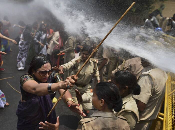 Activists of BJP's women wing held a march and tried to gherao the Uttar Pradesh Chief Minister's office in protest against the rising incidents of atrocities against women in the state. The scheduled protest comes in the wake of the gangrape and murder of two Dalit girls in Badaun district last week. (Source: AP)