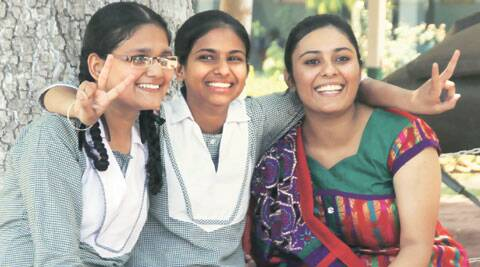PSEB class 10  topper Riya Garg (center) with the2nd place holder Mahima Nagpal(left) and 3rd topper Jannatpreet kaur(right) at R.S.Model Senior Sec. School in Ludhiana on Monday,June 2 2014. Express Photo by Gurmeet Singh
