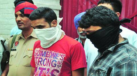 The accused in police custody in Ludhiana on Monday. (Source: Express photos by Gurmeet Singh)