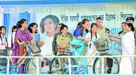 Mamata presents bicycles to girl students at Madarihat, Wednesday. (Source: PTI)