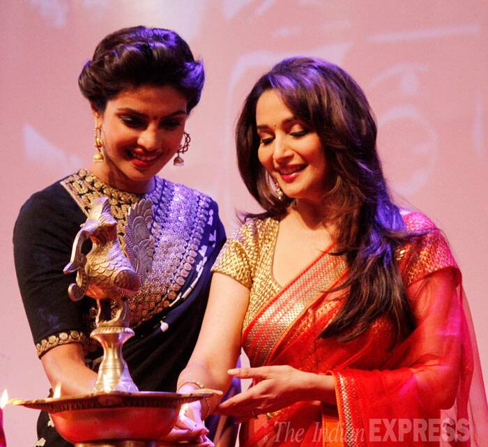 Bollywood beauties Madhuri Dixit and Priyanka Chopra take the stage to light the traditional lamp. (Source: Varinder Chawla)