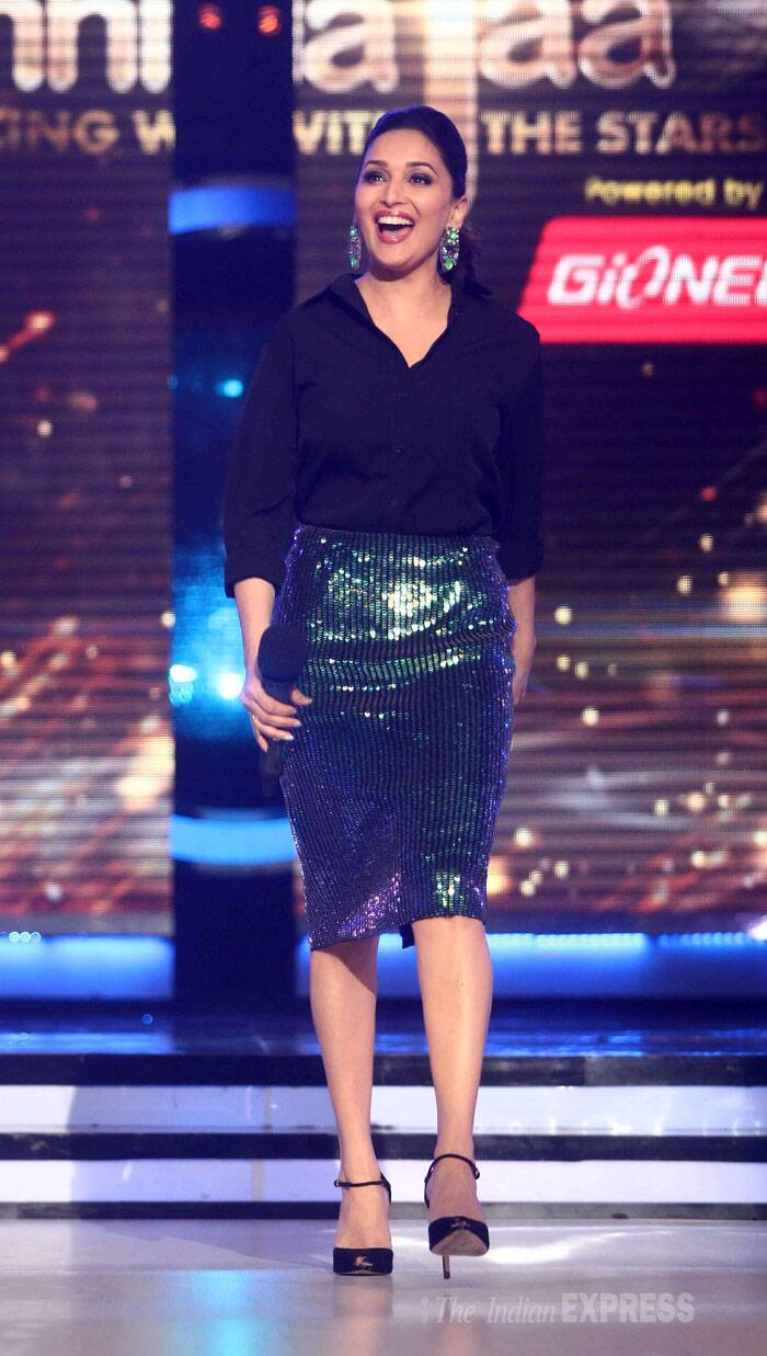 Madhuri Dixit looks super-excited about the new season. She wore a black shirt with a green H&M shimmery skirt and ankle strap heels. (Source: Varinder Chawla)