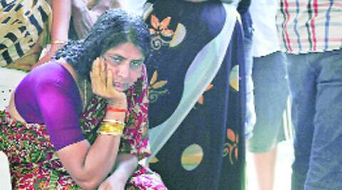 G Sudha Rani grieves beside daughter Aishwarya's body.Source: AP