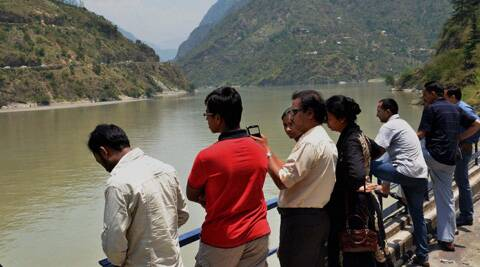 Relatives of the missing engineering students at Pandoh Dam in Mandi on Wednesday.  (Source: PTI)