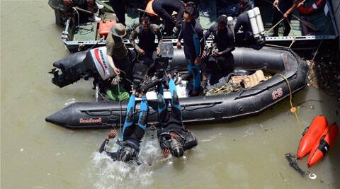Divers jump into the Bhakra Beas Management Board lake to search for the dead bodies in Mandi on Thursday. (Source: PTI)