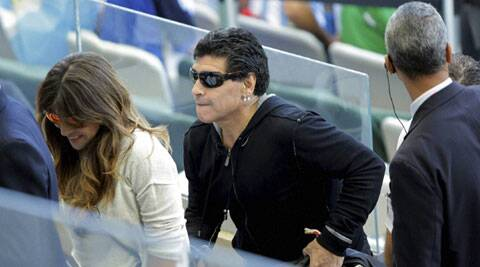 Maradona watched the game at the Mineirao Stadium but left shortly before Messi scored the winner in stoppage time. (Source: AP)