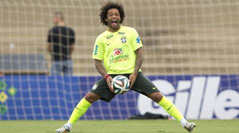 FUNNY MAN: Brazil left-back Marcelo fools around in a training session on the eve of their friendly against Panama in Goiania (Source: AP)
