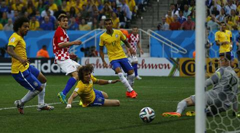Brazil's Marcelo (L) scores his own goal against Croatia on Thursday. (Source: Reuters)