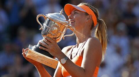 Maria Sharapova claimed her second French Open title when she floored Romanian fourth seed Simona Halep 6-4 6-7(5) 6-4 after a marathon encounter in Saturday's final. (Source: AP)