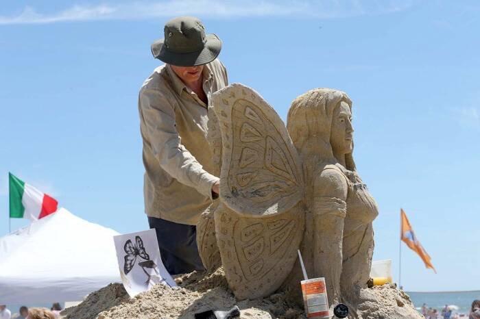 Mark Anderson, of the United Kingdom, works on his sand creation during the DO AC Sand Sculpting World Cup. The competition is organised by the Atlantic City Alliance.  (Source: AP)