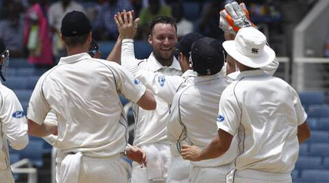 New Zealand's bowler Mark Craig (C) celebrates with teammates after taking the wicket of West Indies Kirk Edwards who was caught by New Zealand's Ross Taylor for a duck. Craig finished with (Source: AP)
