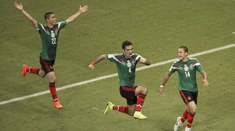 Mexico's Rafael Marquez  (4) celebrates scoring his side's first goal (Source: AP)