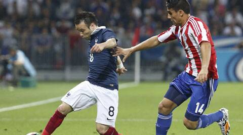 Mathieu Valbuena (L) challenges Paraguay's Junior Alonso during their international friendly ahead of the World Cup. (Source: Reuters)