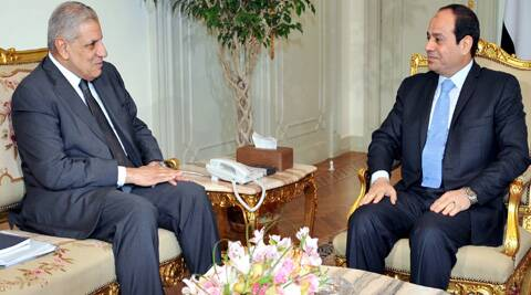 Newly sworn Prime Minister, Ibrahim Mehleb in conversation with President Abdel-Fattah el-Sissi. ( Source: AP )