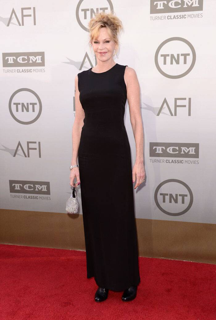 Actress Melanie Griffith picked a plain black gown with a shiny evening bag. (Source: AP)