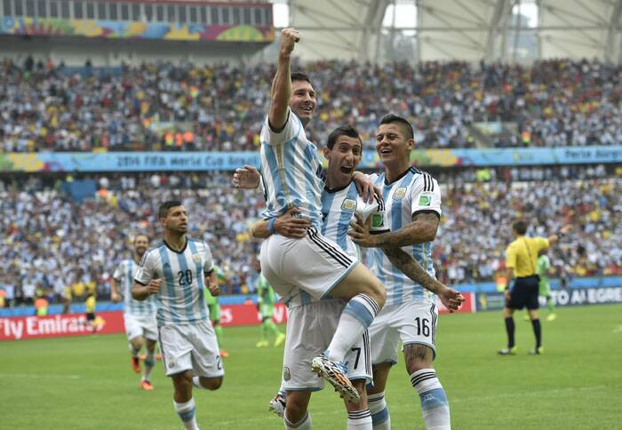 Lionel Messi, the star of Argentina's win, celebrates with teammates Angel di Maria and Marcos Rojo after the match. Argentina finished as leaders of Group F.  (Source: AP)