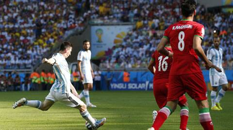 Lionel Messi shoots to score Argentina's winning goal against Iran on Saturday. (Source: AP)