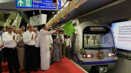 Minister for Urban Development Venkaiah Naidu flags off a Metro train at the Mandi House station during the opening of Mandi House-Central Secretariat line in New Delhi. (Source: PTI)