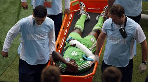 Michael Babatunde being carried out on a stretcher after being hit on the hand by a shot from team mate in the game against Argentina. (Source: Reuters)