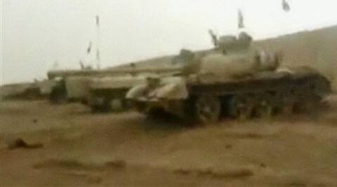 This still image from video taken by militants shows tanks parked at a military compound abandoned by the Iraqi military near Tikrit in Salah al-Din province, Iraq. (Source: AP)
