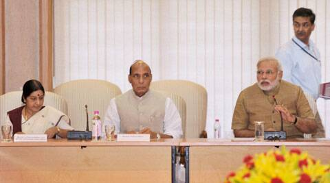 Prime Minister Narendra Modi with Home Minister Rajnath Singh and External Affairs Minister Sushma Swaraj. (Source: PTI)