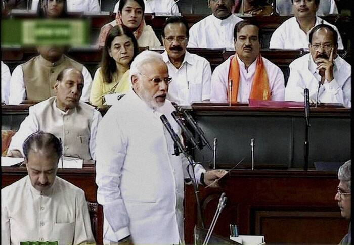 Attired in spotless white, the Prime Minister Narendra Modi was the first to take oath amid thumping of desks. (Source: PTI)