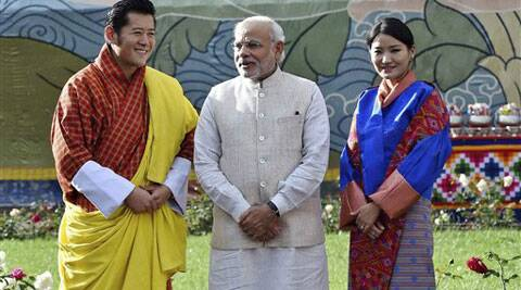 Visiting Indian Prime Minister Narendra Modi, stands with Bhutan's King Jigme Khesar Namgyel Wangchuck, left and Queen Jetsun Pema, right, during a ceremonial reception at Royal Palace in Thimphu, Bhutan. (Source: AP)
