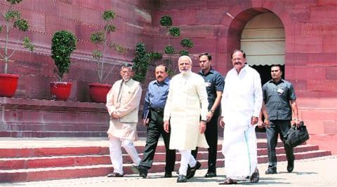 Narendra Modi with Cabinet minister M Venkaiah Naidu and MoS Santosh Kumar Gangwar. Renuka Puri