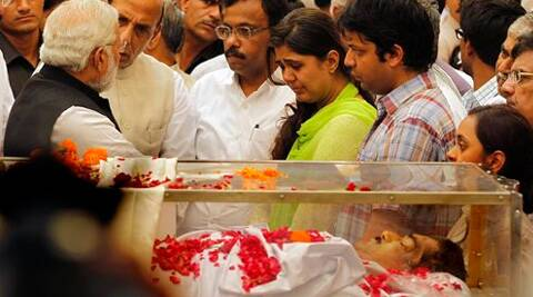 Prime Minister Narendra Modi speaks to the relatives of Gopinath Munde who died in a road accident in Delhi on Tuesday. (Source: PTI)