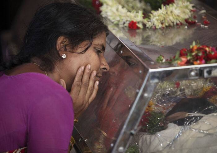 Aishwarya's mother weeps at their residence during her funeral in Hyderabad. (Source: AP)
