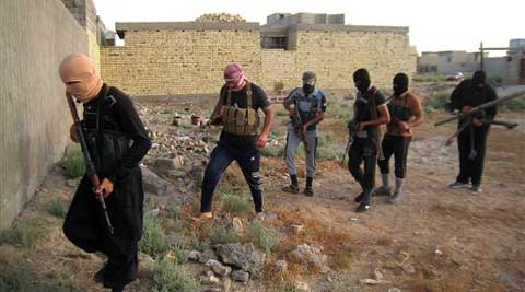 In this file photo dated April 28 armed, masked antigovernment gunmen patrolling Fallujah, Iraq, after Al-Qaida-linked fighters and their allies seized the city months ago. More than 900 people were killed last month, according to figures separately compiled by the United Nations and the government. (Picture source: AP)