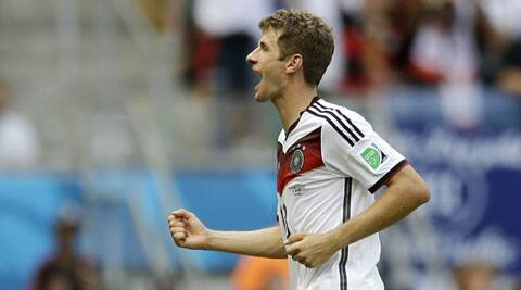 Germany's Thomas Mueller exults after scoring his side's fourth goal against Portugal. (Source: AP)