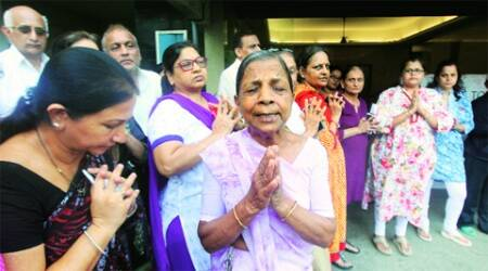 Residents of Campa Cola compound in Worli pray on Thursday. (Express Photo: Prashant Nadkar)