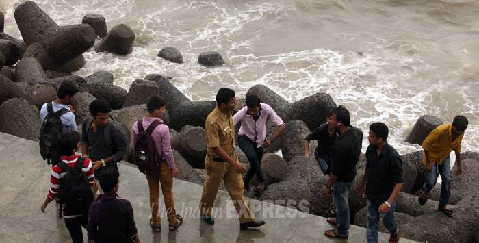 The police kept a strict vigil at the locals trying to get too close to the sea. (Source: Express photo by Prashant Nadkar)