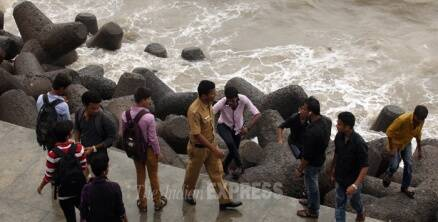 Today in pics: Police keep vigil as high tides continue to hit Mumbai's shores