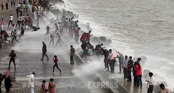 Even as the Municipal Corporation of Greater Mumbai issued warnings for the city residents, many came to the shore to have fun in the waves. (Source: Express photo by Prashant Nadkar)