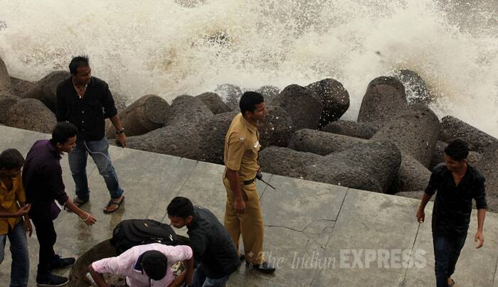 Huge tidal waves continued to hit Mumbai's shores on Wednesday (June 17). (Source: Express photo by Prashant Nadkar)