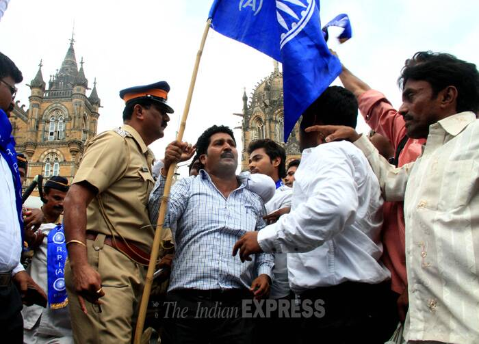 RPI activists shout slogans at the protest. (Source: Express photo by Amit Chakravarty)