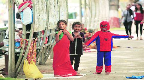 Street children play in the city on Sunday.(Express photo by Ganesh Shirsekar)