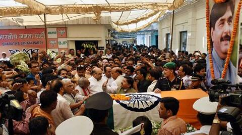 BJP leaders and supporters gather to pay their respects to the mortal remains of Union minister Gopinath Munde is brought at the BJP headquarters in New Delhi on Tuesday. (Source: PTI)